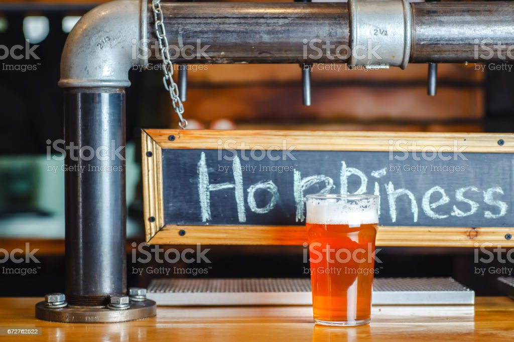 Pale ale on a bar counter stock photo