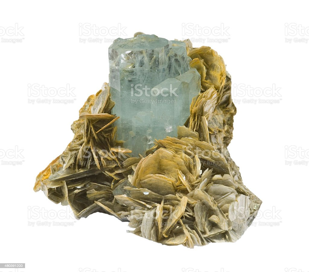 Pale blue Aquamarine crystal, with mica, isolated on white. stock photo