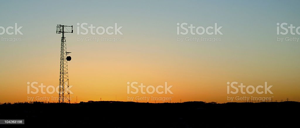 Pale Blue Cell Phone Tower Sunset stock photo