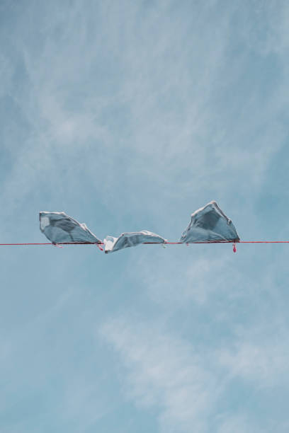 pale blue retro y-front underpants on a washing line against a blue sky. - washing line stock photos and pictures