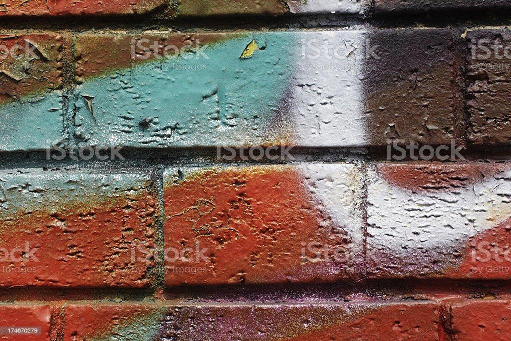 Spray paint design wall bricks in bold colours stock photo