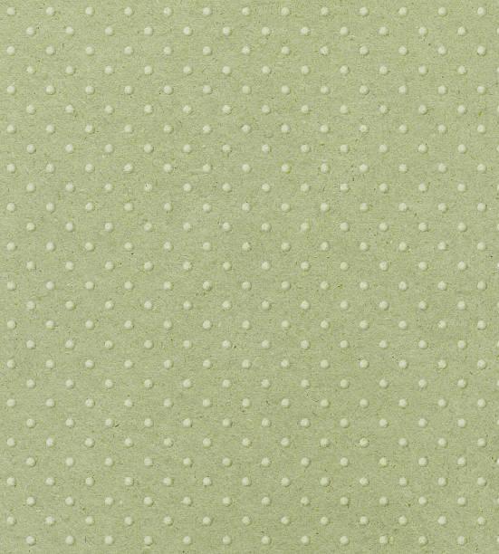 zartes grün papier mit strukturierten punkten - brokat stock-fotos und bilder