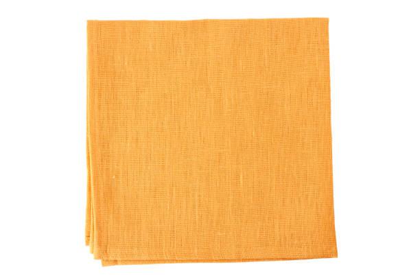 Pale orange textile napkin on white stock photo