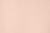 Pale pink colored low contrast Concrete textured background with roughness and irregularities