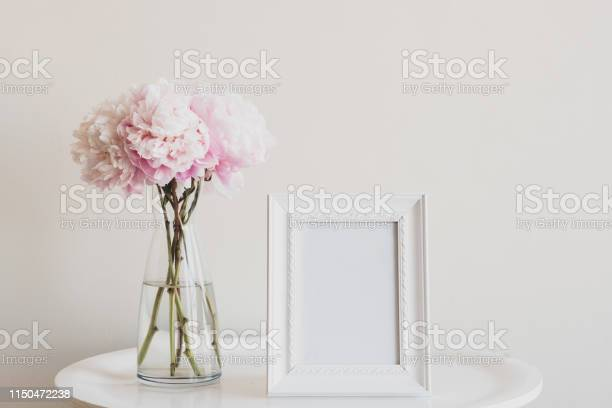 Pale pink peonies with blank rectangular picture frame on table picture id1150472238?b=1&k=6&m=1150472238&s=612x612&h= jrjx59rqplnmd19qqooe3qiidv2ydjorkjtmgv9iqy=