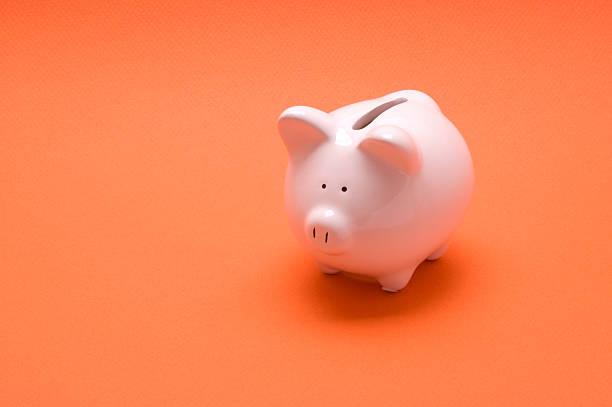 Sparschwein auf Orange – Foto