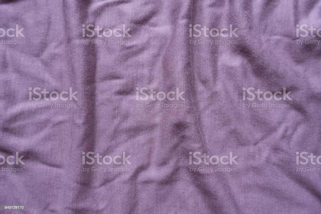 Pale pink viscose fabric with folds from above stock photo