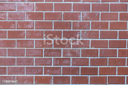 905087856istockphoto pale red brick wall background texture. 1130675547