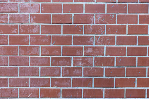 905087856 istock photo pale red brick wall background texture. 1130675547