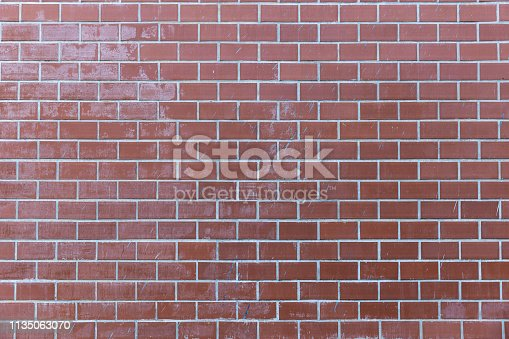 905087856istockphoto pale red brick wall background texture. 1135063070
