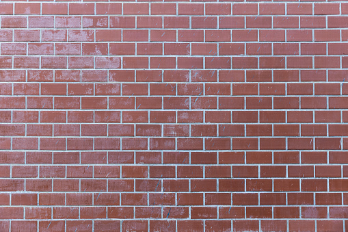 905087856 istock photo pale red brick wall background texture. 1135063070