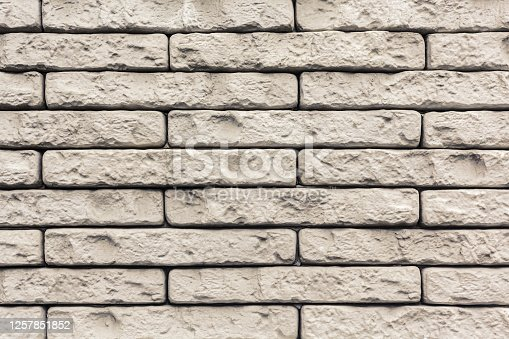 Pale stone wall texture. Abstract beige masonry background