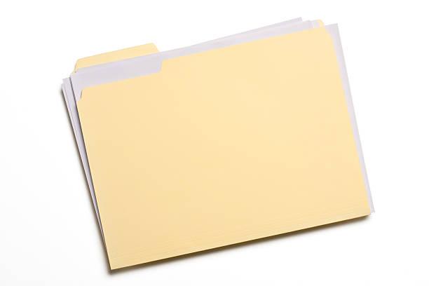 Pale yellow file folder on white background stock photo