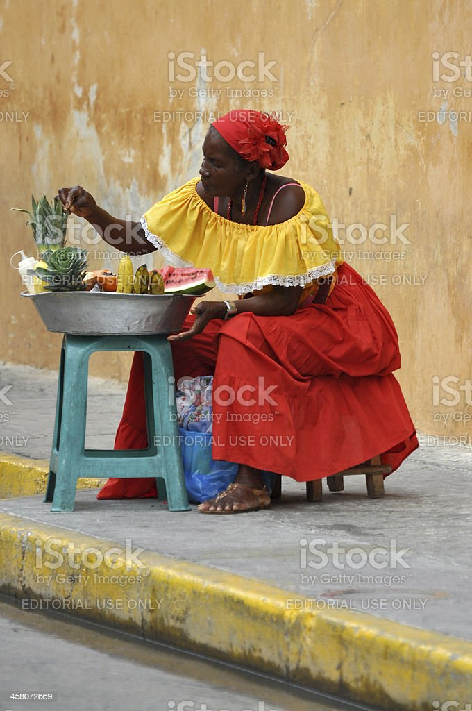 Palenquera woman sells fruit in Cartagena, Colombia royalty-free stock photo