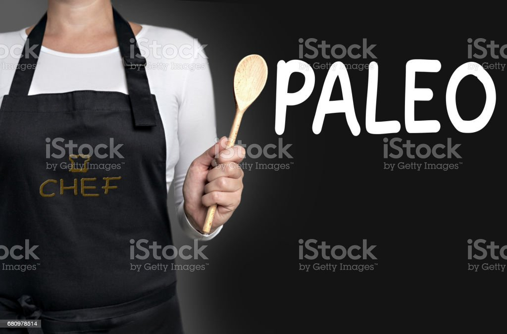 paleo cook holding wooden spoon background concept royalty-free stock photo
