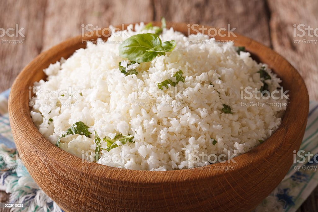 Paleo Food: Cauliflower rice with herbs close-up. horizontal stock photo