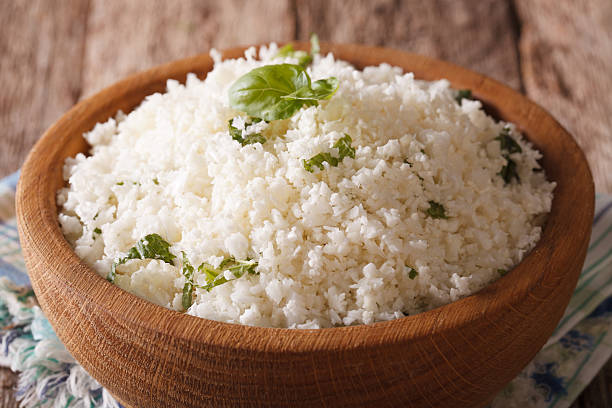Paleo Food: Cauliflower rice with herbs close-up. horizontal stock photo