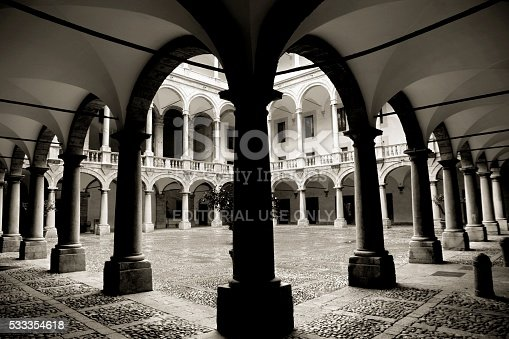 Palermo, Italy - February 3, 2012: Wide angle view of the colonnade of the inner courtyard of the