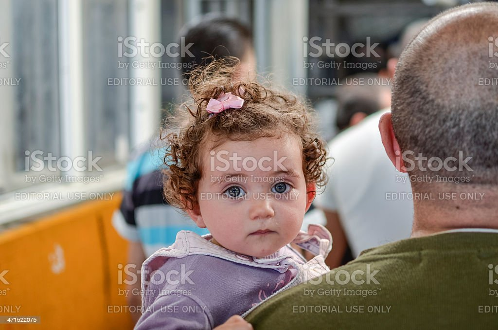 Palestinian child at an military Checkpoint stock photo