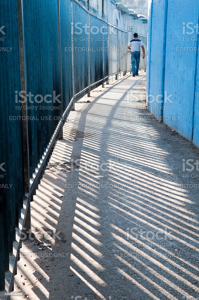 Palestinian exiting Israeli checkpoint stock photo