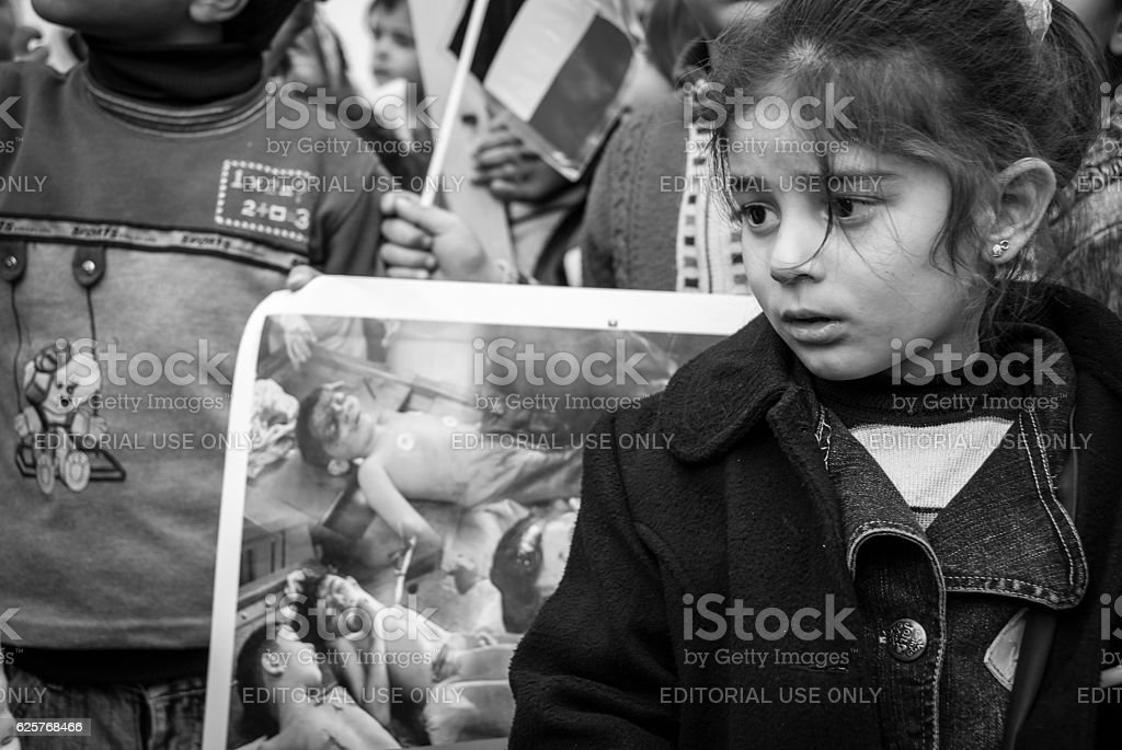 Palestinian girl in Ramallah at protest over Gaza City murders stock photo