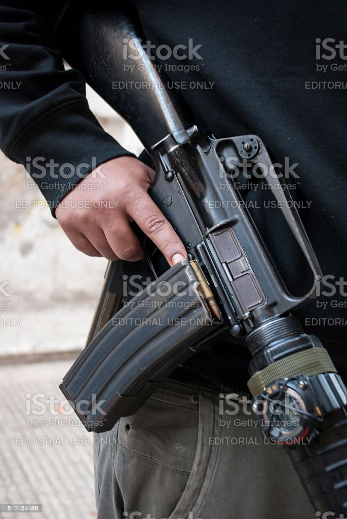 Palestinian man with automatic weapon in Nablus stock photo