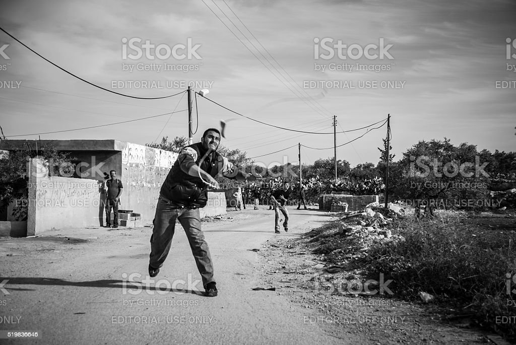 Palestinian man with slingshot in West Bank village Bil'in stock photo