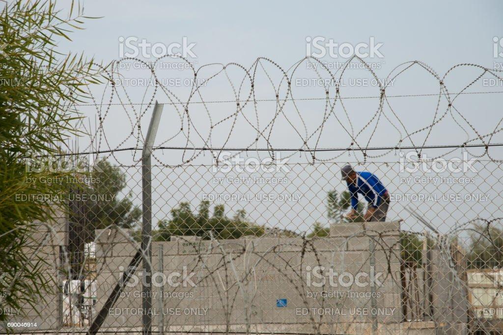 Palestinian worker in West Bank Israeli settlement stock photo