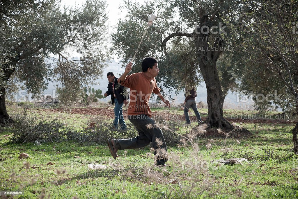 Palestinian youth with slingshot in West Bank village Bil'in stock photo