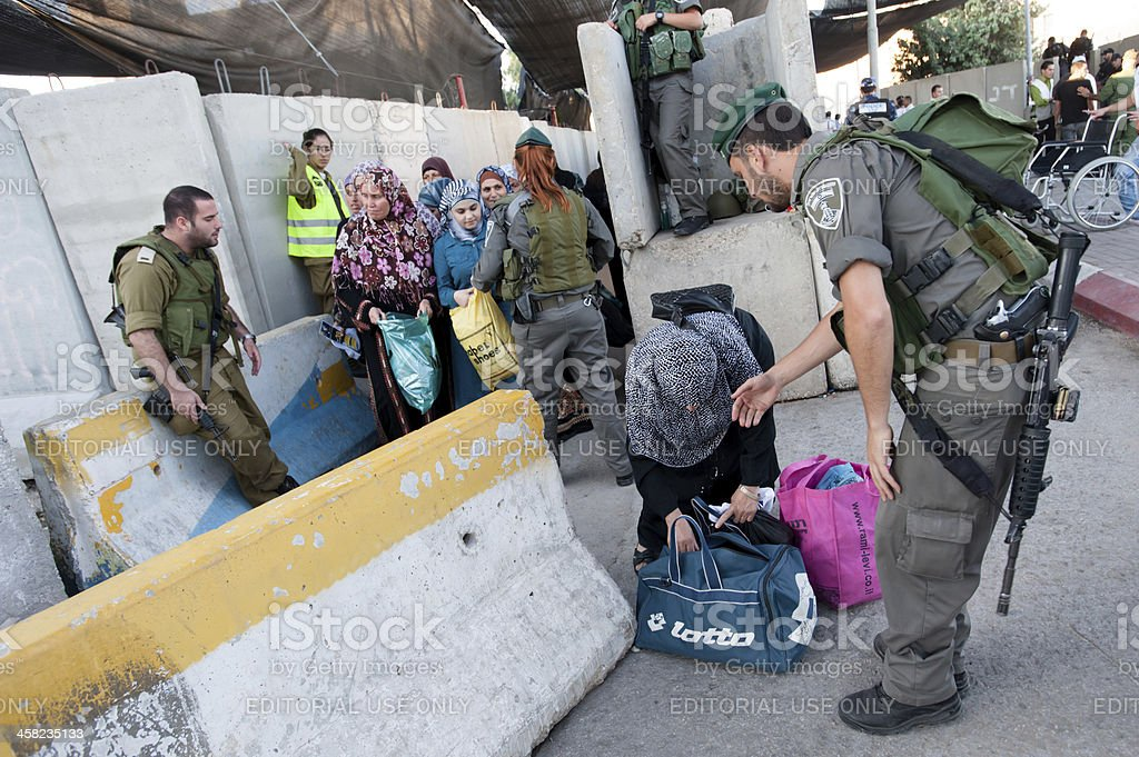 Palestinians at Israeli military checkpoint stock photo