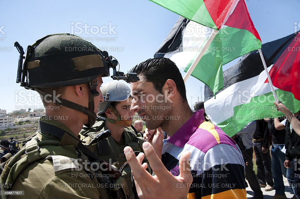 Palestinians protest Israeli wall stock photo