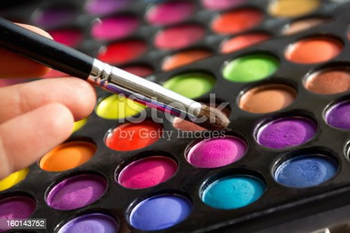 palette of colors with a brush