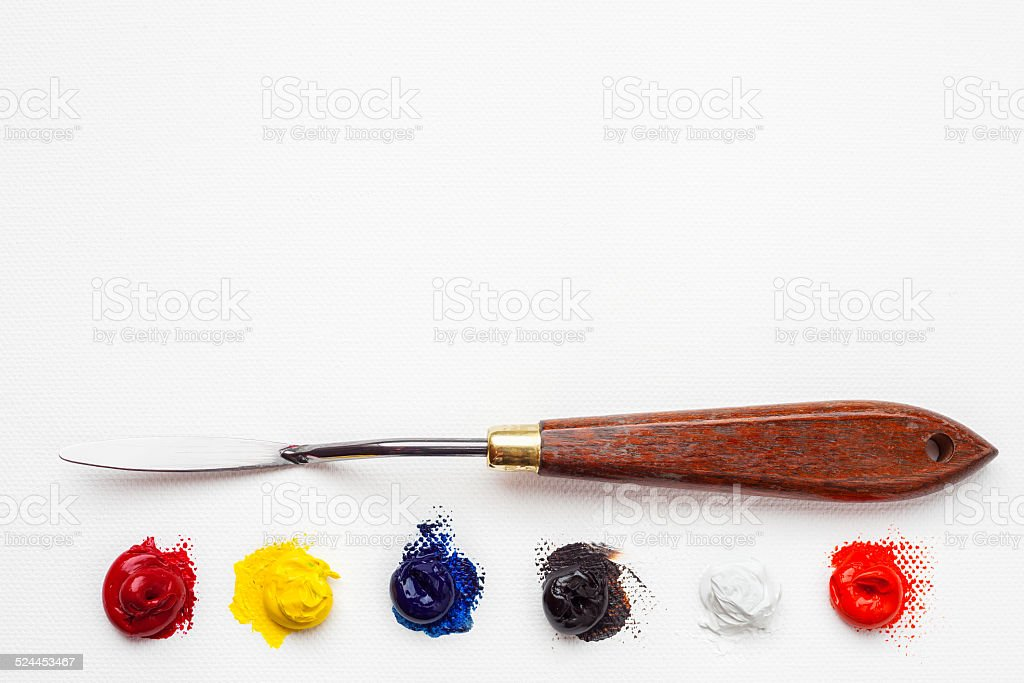 palette knife and oil paint on white canvas stock photo