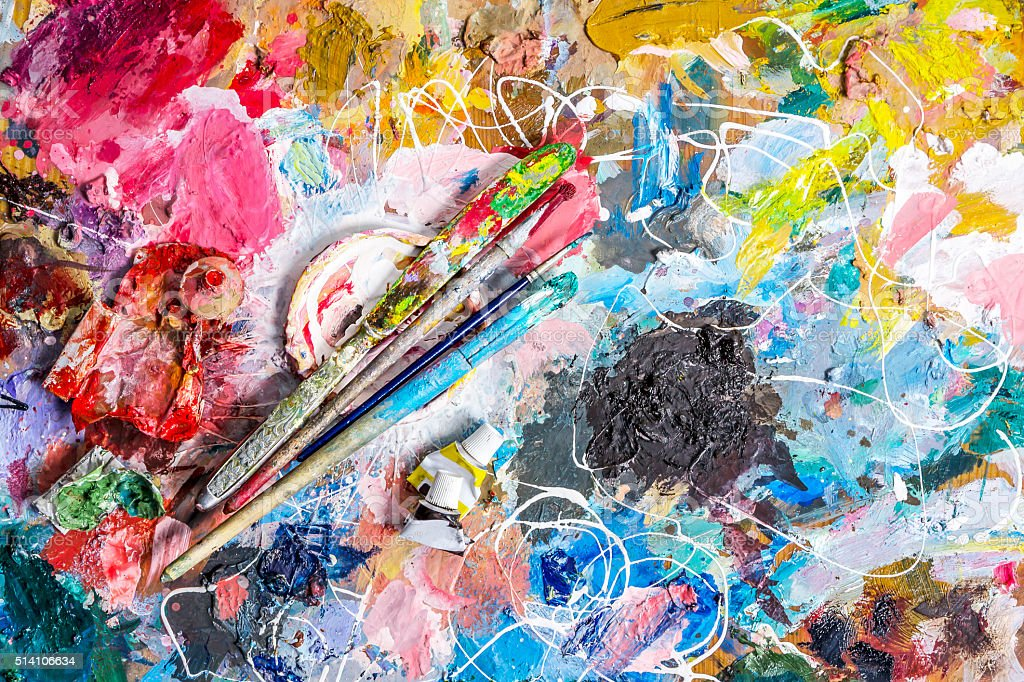 Palette of artist  and brushes with  knife stock photo