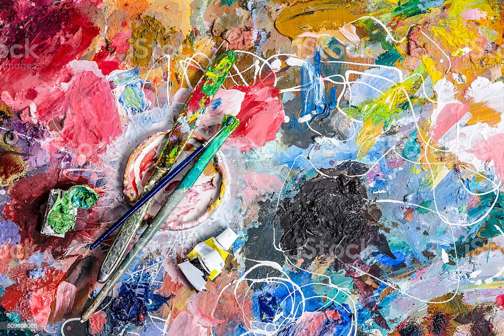 Palette of artist for mixing paints and brushs with knife stock photo