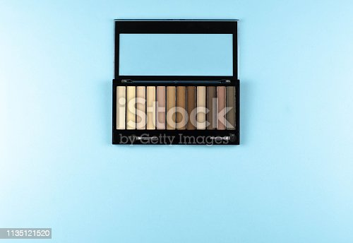 istock Palette of shades of brown on a blue background. 1135121520