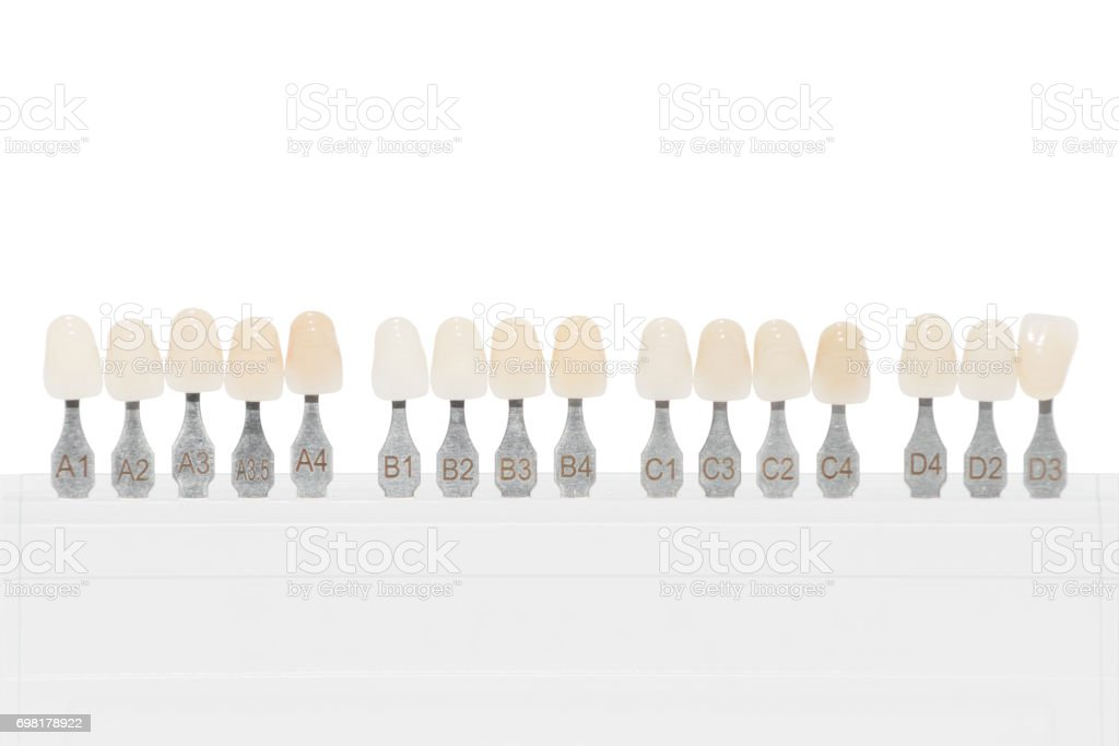 Palette Of Shades Of Teeth Isolated On White Stock Photo