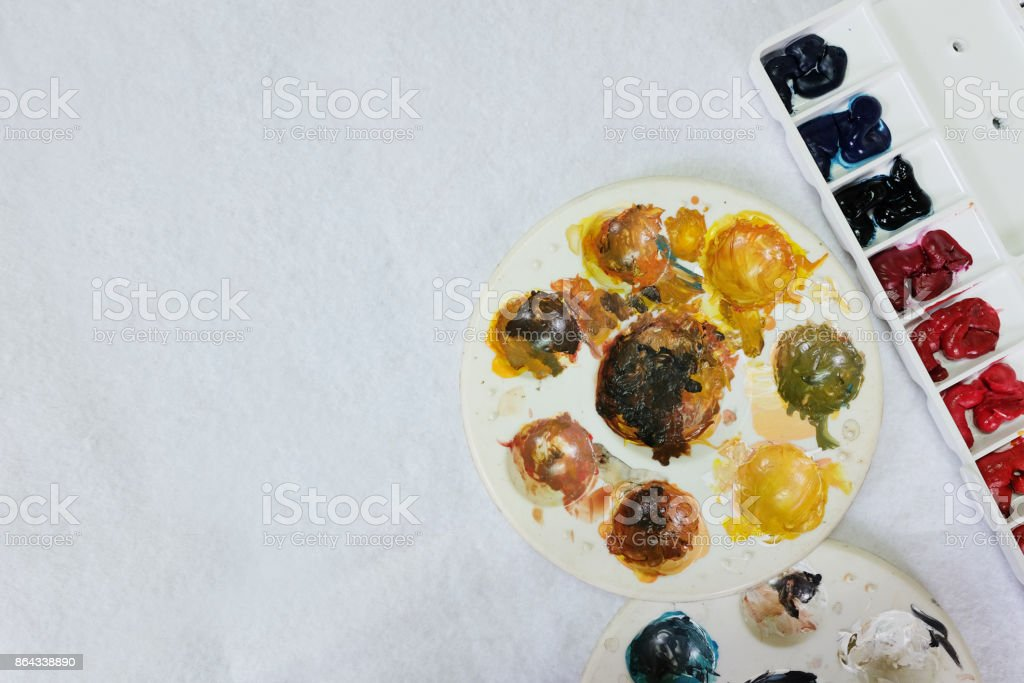 Palette of watercolor and Circle Palette of Acrylic color paints on white background-copy space stock photo