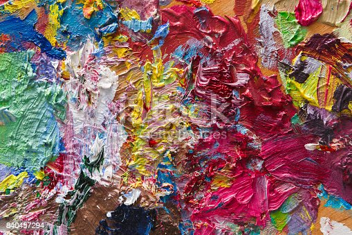 istock Palette with colorful mixed oil-paints texture 840457294