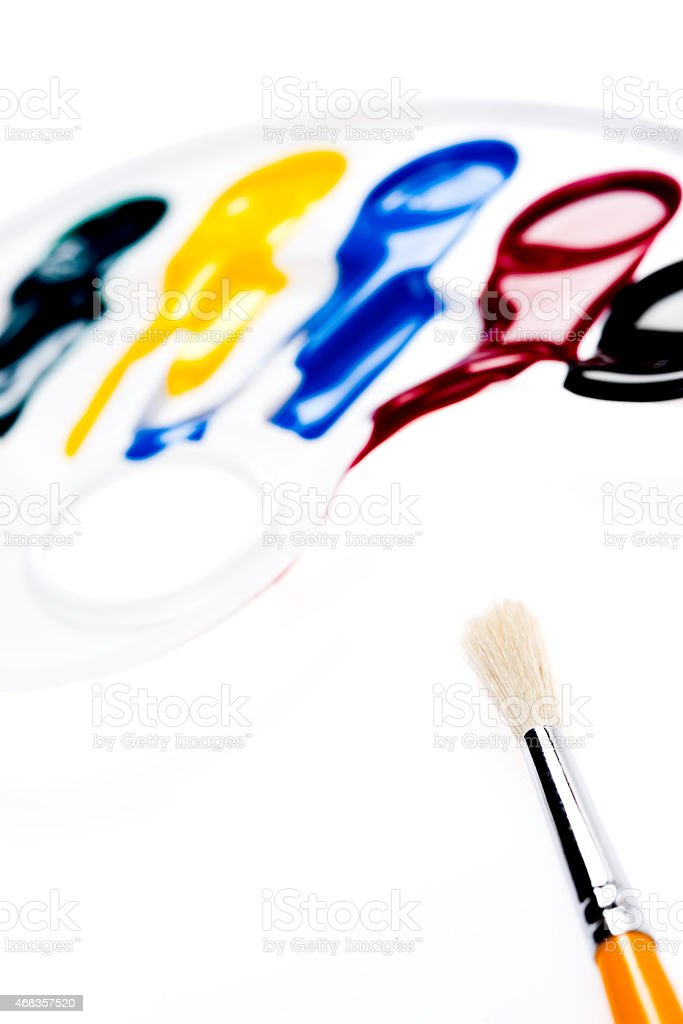 Palette with colors and brush royalty-free stock photo