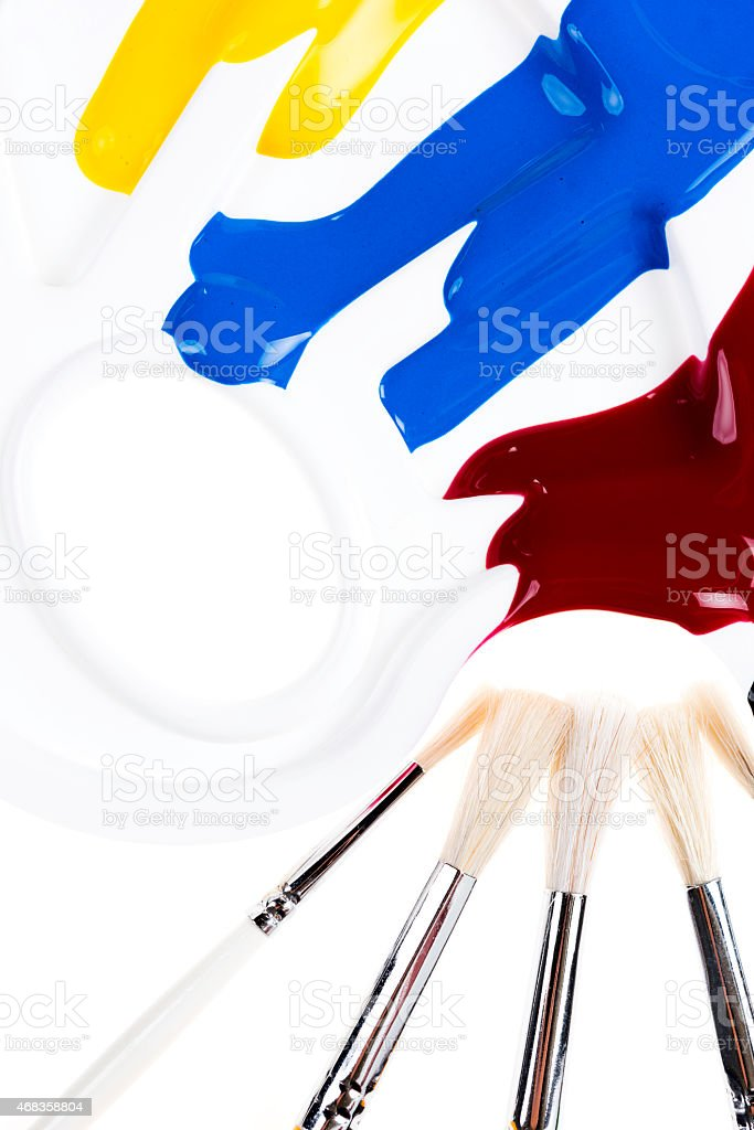 Palette with colors and brushes royalty-free stock photo