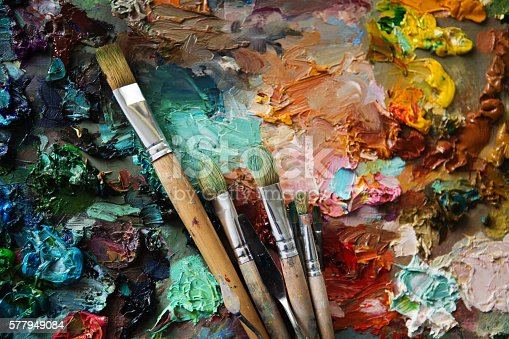 istock palette with paintbrush and palette-knife 577949084