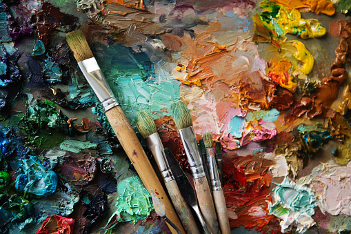 577949148 istock photo palette with paintbrush and palette-knife 577949084