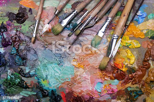 istock palette with paintbrush and palette-knife 577949822
