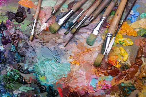 577949148 istock photo palette with paintbrush and palette-knife 577949822