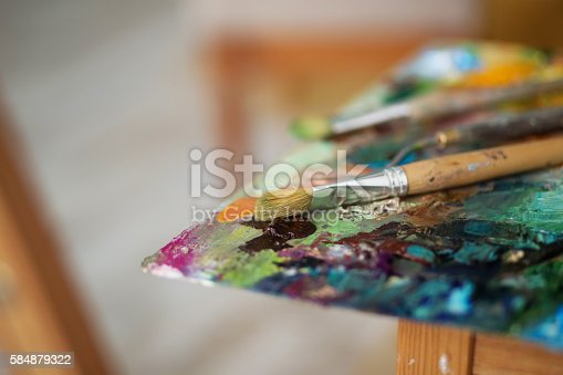 istock palette with paintbrush and palette-knife 584879322