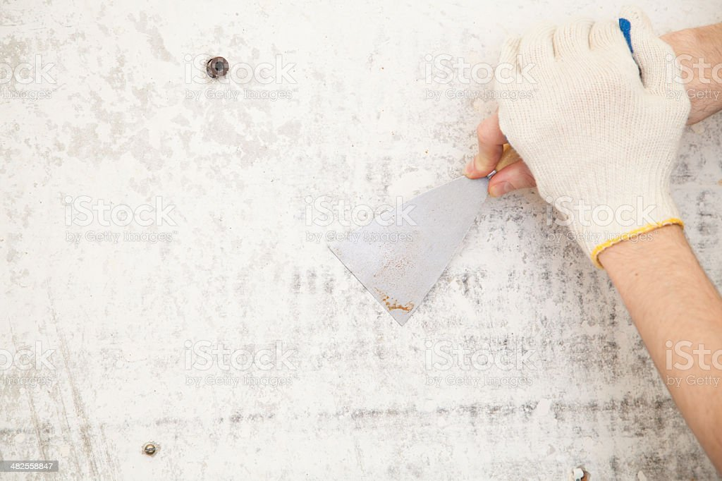 palette-knife in hand stock photo