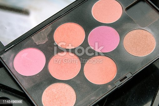 Palettes of multicolor cosmetic make up, eye shadow palette, colorful shadows texture background. close-up