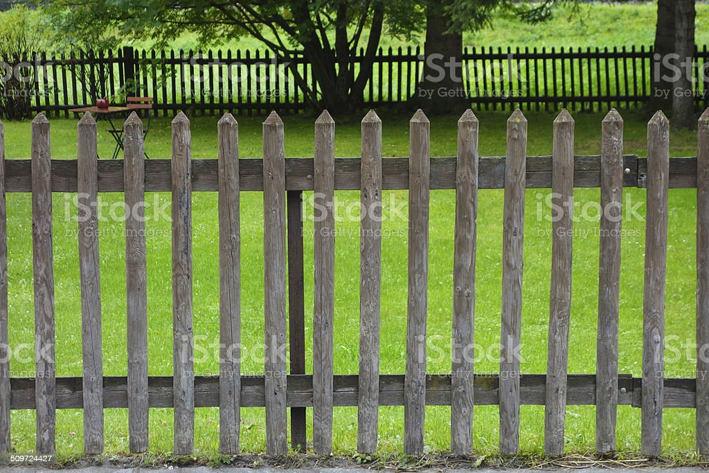 Paling and garden behind stock photo