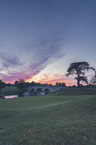 A beautiful sunset over the Palladian Bridge at Brocket Hall, Hertfordshire.